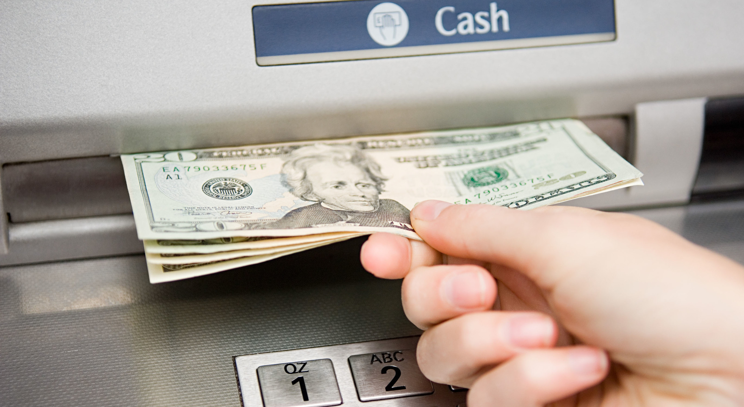 ap9ctt-person-withdrawing-cash-atm-machine-money-dollar-bills-bank-banking-fees-financial-institution-2